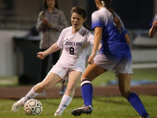 Maclay's Katie Lynch dribbles the ball past Rocky Bayou.