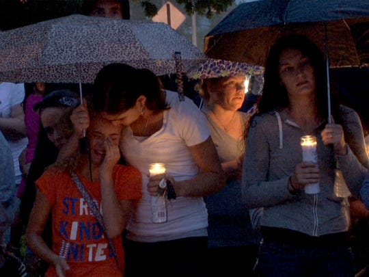 """People gather for a vigil in memory of AbbieGail """"Abbie"""" Smith, 11, Friday night,  July 14, 2017.  Smith was killed by a neighbor in her Keansburg apartment complex Friday,  July 14, 2017, near where the remains of 11-year-old Abbiegail 'Abby' Smith were found Thursday."""
