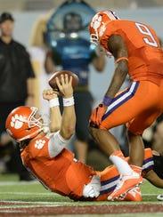Clemson quarterback Cole Stoudt (18) reacts after scoring