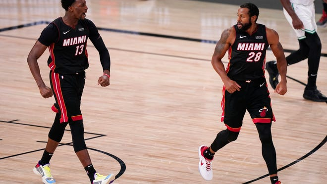 Miami Heat's Bam Adebayo (13) reacts to a basket along with teammate Andre Iguodala (28) during the second half of an NBA conference final playoff basketball game Sunday, Sept. 27, 2020, in Lake Buena Vista, Fla.