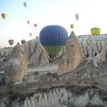 Looking out over the exotic Cappadocian highlands of central Turkey while on a early-morning hot-air balloon ride.
