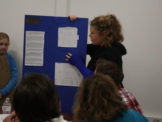 Destiny Dupuy, 12, of Binghamton, presents her plans