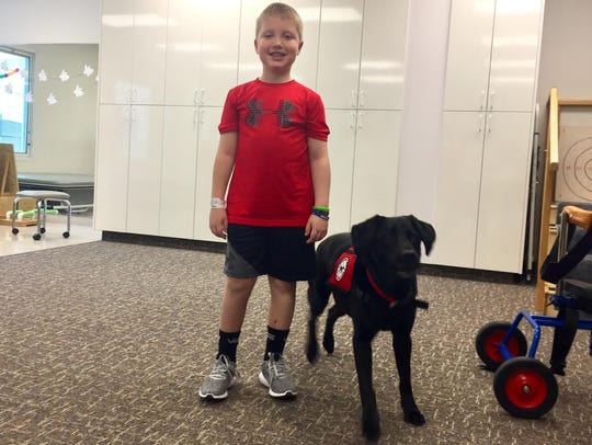 Rhett Klinger, 7, was hit by a car riding his bike