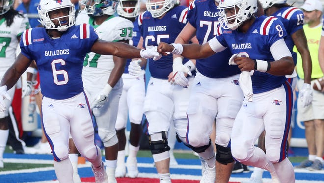 Louisiana Tech running back Boston Scott (6) congratulates quarterback J'Mar Smith (8) with a fist bump after he scores a touchdown against North Texas at Joe Aillet Stadium in Ruston, La., Saturday, Nov. 4, 2017.