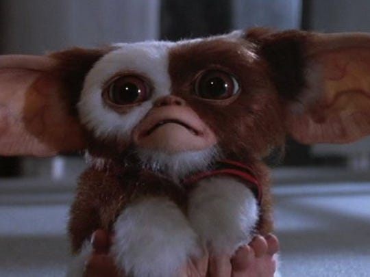 "Gizmo and his less cute colleagues star in ""Gremlins,"""