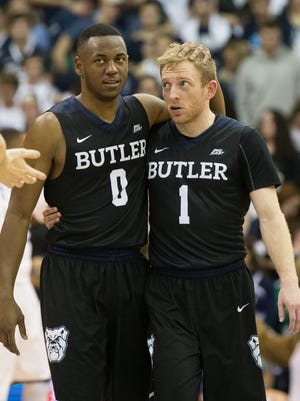 Bulldogs guard Avery Woodson (0) and guard Tyler Lewis (1) embrace as time winds down on a victory against Villanova at The Pavilion. Butler won 74-66.
