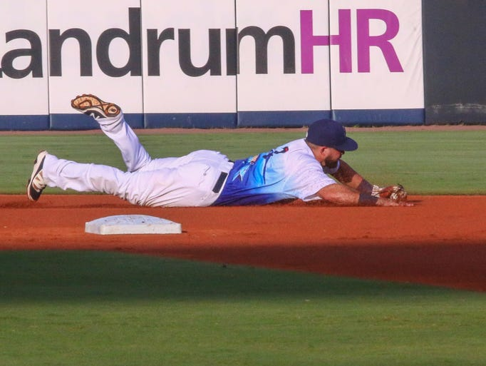 Blue Wahoos shortstop Blake Trahan (7) makes a diving