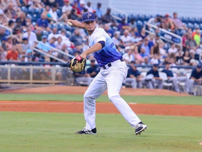 Blue Wahoos pitcher Jesus Reyes (17) fields a short
