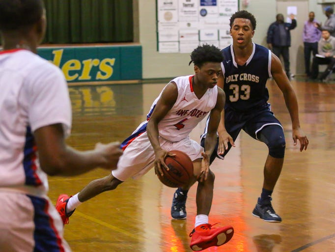 Pine Forest's D'ante Dean (4) moves the ball up the
