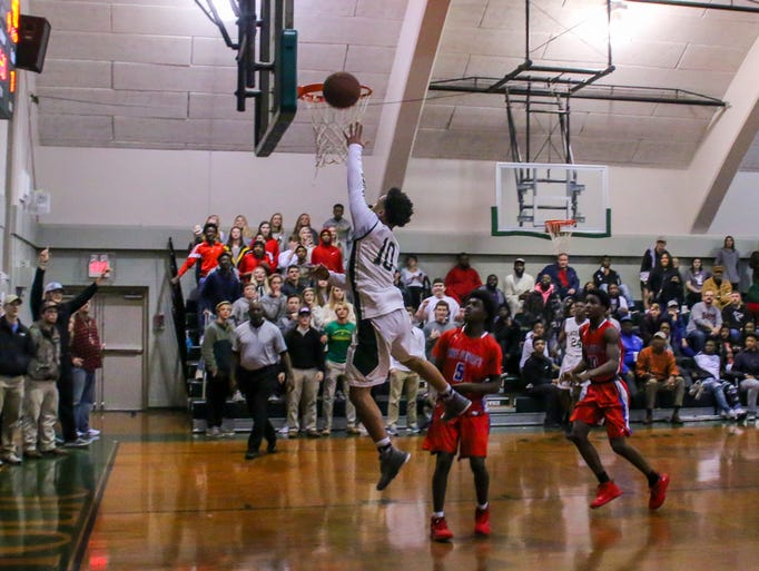 Catholic's Demarius Nickerson (10) lays in the final