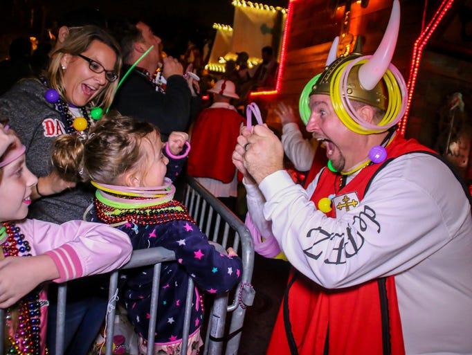 The Krewe of Lafitte Illuminated Night Parade rolls