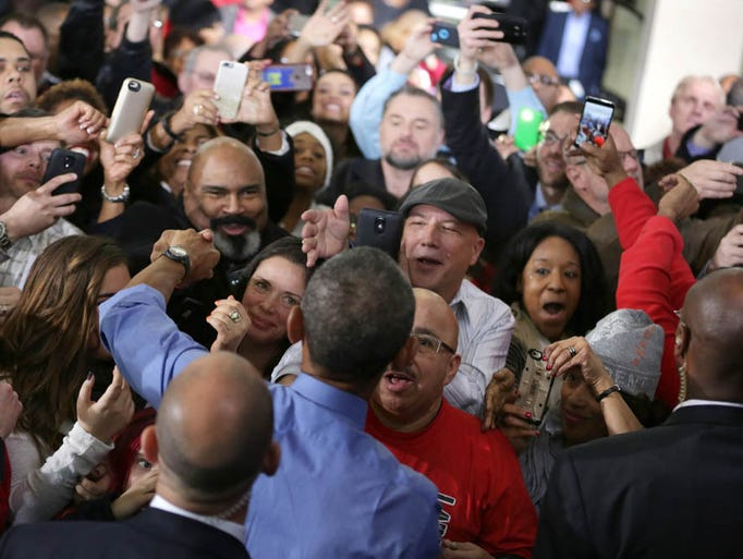 President Obama interacts with the crowd after delivering