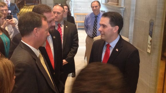 Likely GOP presidential contender and Wisconsin Gov. Scott Walker (right) speaks with two GOP state lawmakers Thursday at the Tennessee statehouse.