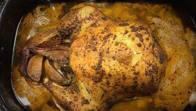 The bird essentially braised and steamed in its flavorful liquid overnight and emerged golden, moist, and falling-from-the-bone tender.