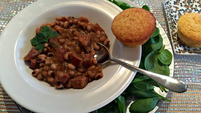 Black-eyed peas are served with greens and cornbread.