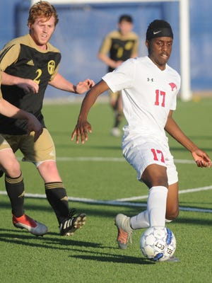 Cooper's Sylva Uwimana (17) passes the ball while two Amarillo High players give chase. Cooper beat the Sandies 2-0 in the Region I-5A bi-district playoff game Friday, March 30, 218 at the Frenship Soccer Complex in Wolfforth.