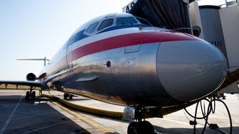 An American Airlines MD-80 passenger jet rests on the ramp at Gate A8 at Dallas Ft-Worth International Airport on Aug. 5, 2015.