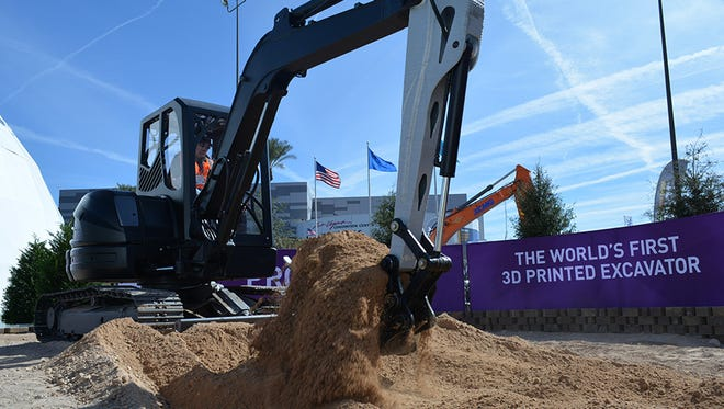 The Project AME excavator, with major parts printed at Oak Ridge, was exhibited at the CONEXPO-CON/AGG annual show in Las Vegas.