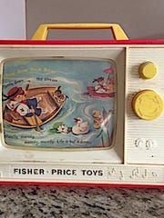 "Kathleen Rendini can't let go of her Fisher Price ""radio."""