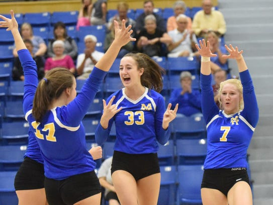 Lady Bombers celebrate a point against Brookland on