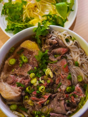 """The phở, pronounced """"fuh"""", is a traditional Vietnamese noodle soup. At Mà's Kitchen in Tamuning, a diner can order this soup in different variations through a combination of toppings, types of noodles, and possibly unexpected add-ons available to enjoy the dish through a customized dining experience."""