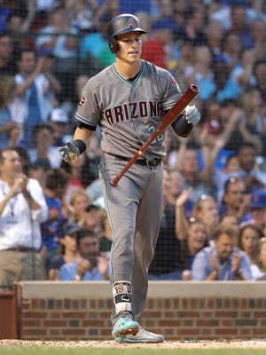 Arizona Diamondbacks' Jake Lamb reacts after striking out with the bases loaded to end the top half of the third inning against the Chicago Cubs in a baseball game Tuesday, July 24, 2018, in Chicago.