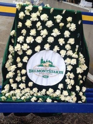 American Pharoah's Belmont Stakes garland of white carnations, positioned outside Bob Baffert's barn at Churchill Downs, has been a popular picture subject.
