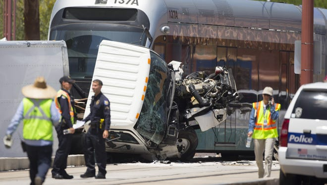 Police respond to a truck and a light-rail car collided at Central and Claredon in Phoenix, AZ on May 9, 2015.