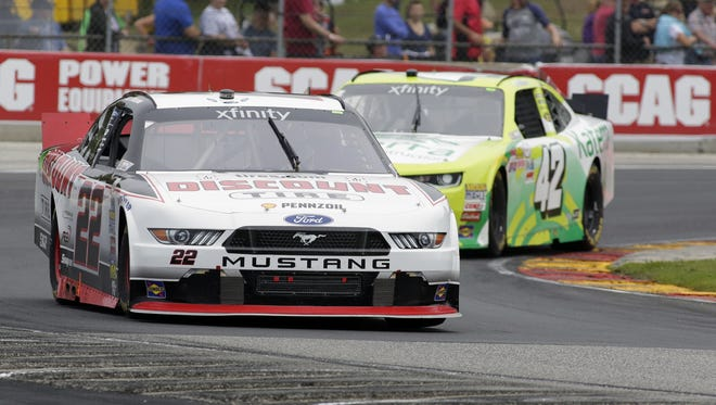 Alex Tagliani (22) leads Justin Marks (42) around turn 5 during the NASCAR Xfinity Road America 180 Powered Up By Johnsonville on Saturday.