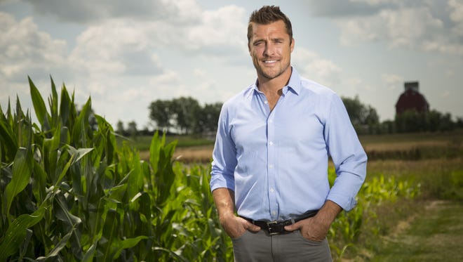 """Chris Soules, a star of ABC's """"The Bachelor,"""" stands for a portrait on a farm near Alden on July 17, 2014."""