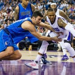 Dallas center Zaza Pachulia and Kings guard Ben McLemore scramble after a loose ball during Sunday's game in Sacramento.