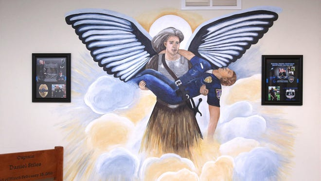 This mural in the Uniontown Police Department pays tribute to two fallen officers. The mural was created by two students from Lake Center Christian School.