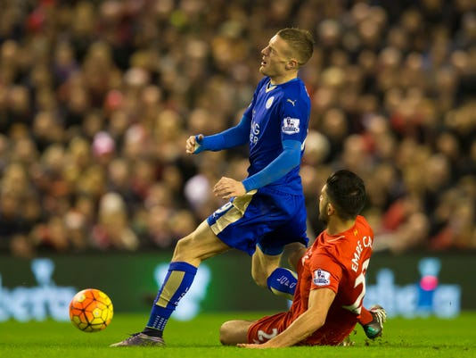 Leicester City's Jamie Vardy, left, is brought down by  Liverpool's Emre Can during the English Premier League soccer match between Liverpool and Leicester City at Anfield Stadium, Liverpool, England, Saturday, Dec. 26, 2015. (AP Photo/Jon Super)