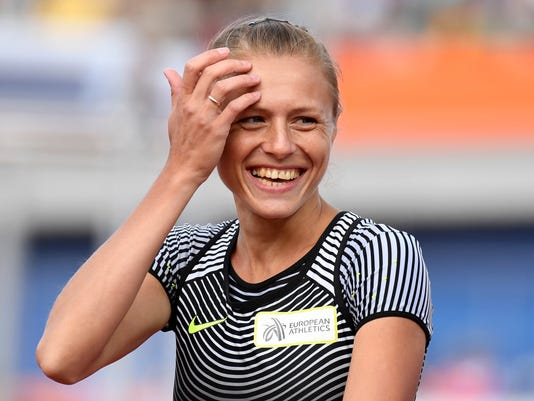 Russian doping whistleblower Yuliya Stepanova who runs under a neutral flag smiles before competing in a women's 800m heat during the European Athletics Championships in Amsterdam, the Netherlands, Wednesday, July 6, 2016. (AP Photo/Geert Vanden Wijngaert)