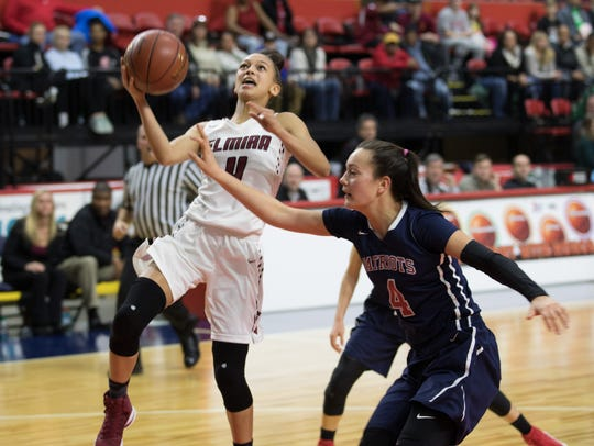 Elmira's Kiara Fisher works around Annie Ramil in the