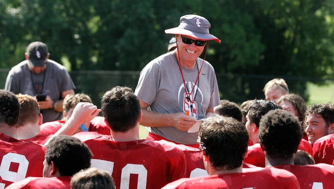Stewarts Creek football coach David Martin talks with his team after practice this week.