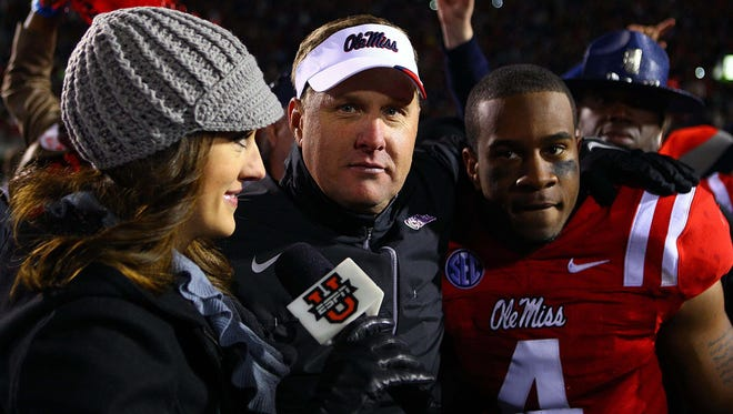 Ole Miss sophomore linebacker Denzel Nkemdiche, pictured with coach Hugh Freeze after a win last Nov. 24, is out for four to six weeks with a knee injury.