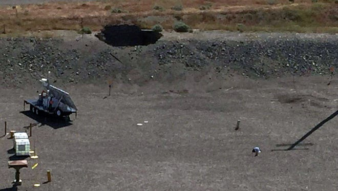 A robotic camera captured this image May 9, 2017, of a 20-foot-by-20-foot hole in the roof of a tunnel where rail cars carrying high concentrations of nuclear waste are buried at Hanford Nuclear Reservation about 20 miles northwest of Richland, Wash.