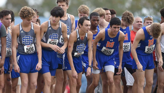Ocean Springs and Madison Central runners prepare to start the Class 6A race on Saturday, November 4, 2017, in the MHSAA Class 6A-4A-2A State Cross Country Meet at Choctaw Trails in Clinton, Miss.