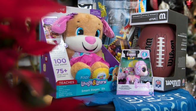 A small selection of the dozens of Christmas gifts available to families in need is seen Wednesday, Dec. 20, 2017, at Medina Flower and Gift Shop. On Saturday, A Lending Hand will provide families with the opportunity to acquire Christmas gifts for their children.