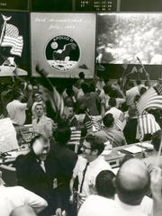 The Apollo 11 crew splashed down in the Pacific Ocean more than eight days after launching into space on the Saturn V rocket. Flight controllers in NASA's Mission Operations Control Room celebrated a successful mission with cheers.