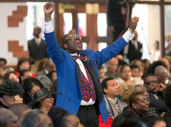 Elder Cal Murrell reacts to a speaker during the Rev. Martin Luther King Jr. holiday commemorative service Jan. 20, 2014, at Ebenezer Baptist Church in Atlanta. The service at the church where King preached featured prayers, songs, music and speakers.
