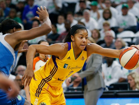 FILE - In this Sunday, Oct. 9, 2016, file photo, Los Angeles Sparks forward Candace Parker (3) controls the ball over Minnesota Lynx forward Rebekah Brunson in the first half of Game 1 of the WNBA basketball finals in Minneapolis. It doesn't seem that long ago that the Los Angeles Sparks were celebrating their first WNBA championship in 14 years with a thrilling deciding Game 5 victory over the Minnesota Lynx. Now the WNBA is set to begin its 21st season next month with training camps opening up around the league on Sunday, April 23, 2017, and Monday. (AP Photo/Stacy Bengs, File)
