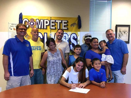 Bloomfield's Destiny Walther signs a letter of intent to play basketball for Haskell Indian Nations University.