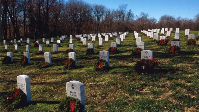Wreaths decorate graves at the Veterans Cemetery near Hopkinsville, Ky.