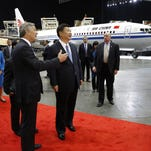 """Chinese President Xi Jinping talks about how the Chinese symbol for the word """"people"""" resembles two sticks supporting each other as he speaks Tuesday, Sept. 22, 2015, at a banquet in Seattle. Xi was in Seattle on his way to Washington, D.C., for a White House state dinner on Friday."""