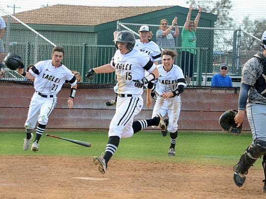 Abilene High's J.D. Dugger scores the winning run while teammates celebrate in the Eagles 7-6 walk-off win over Keller Fossil Ridge on Friday at Blackburn Field.