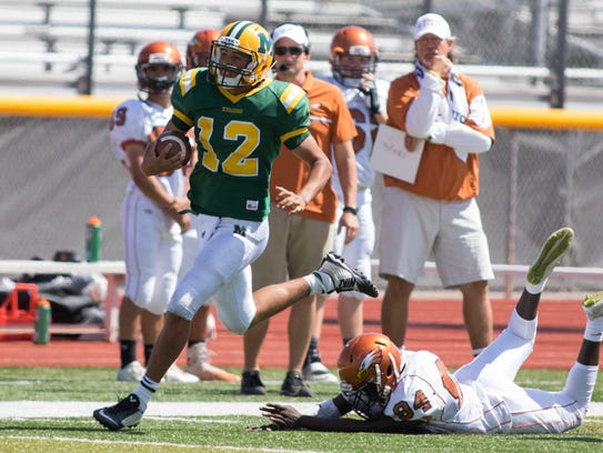 Mayfield quarterback Torry Locklin finds running room