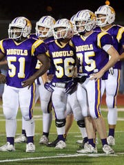This picture of the Munday offensive line was taken during a seven-game winning streak two years ago. Since then, Munday has won one game in the past two seasons as the numbers in the program continue to dwindle.