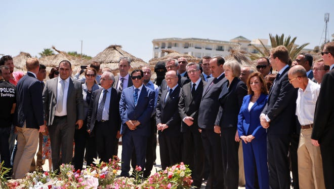 French Interior Minister Bernard Cazneuve, center, his German counterpart, Thomas de Maizière, center right, and British Home Secretary Theresa May, fifth from right, attend a wreath-laying ceremony at the site of a terror attack on tourists on a beach outside the Imperial Marhaba Hotel in Sousse, Tunisia.